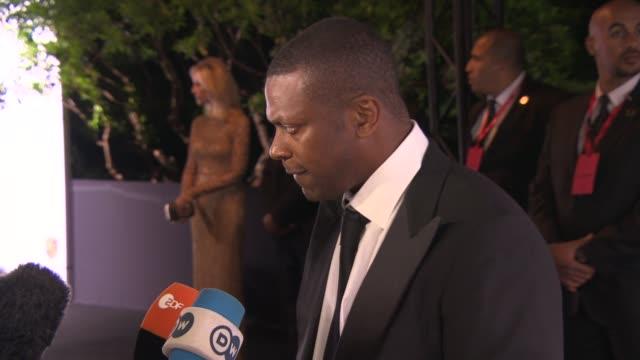 INTERVIEW Chris Tucker on being at the event at De Grisogono Party at Hotel du CapEdenRoc on May 20 2014 in Cap d'Antibes France