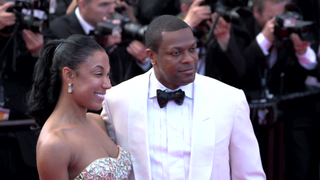 Chris Tucker unidentified date posing for paparazzi along the red carpet at Grand Theater Lumiere