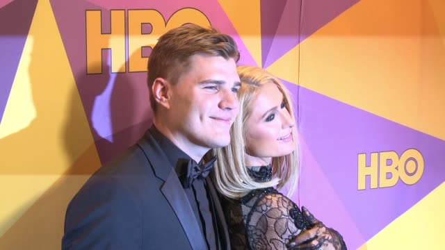 chris zylka and paris hilton at the hbo post golden globes party at circa 55 restaurant on january 07 2018 in los angeles california - パリス・ヒルトン点の映像素材/bロール