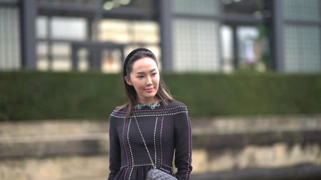 chriselle lim wears a black dress, a bag, outside valentino, during paris fashion week womenswear fall/winter 2018/2019, on march 4, 2018 in paris,... - black dress stock videos & royalty-free footage
