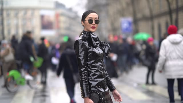 chriselle lim wears a black shiny pvc dress sunglasses outside balmain during paris fashion week womenswear fall/winter 2018/2019 on march 2 2018 in... - pvc stock videos and b-roll footage