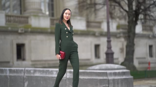 chriselle lim wears a green suit a red bag outside elie saab during paris fashion week womenswear fall/winter 2018/2019 on march 3 2018 in paris... - sfilata video stock e b–roll