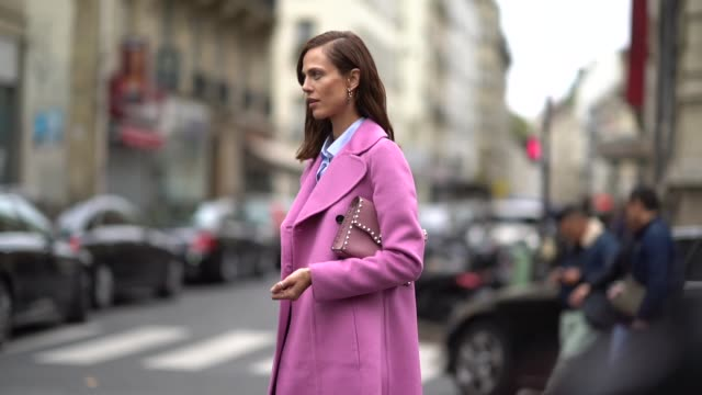 chriselle lim wears sunglasses, a pink jacket, a pink skirt, black thigh high boots, a pink bag, outside valentino, during paris fashion week... - thigh human leg stock videos & royalty-free footage
