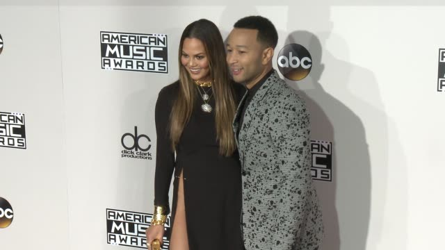 Chrissy Teigen and John Legend at 2016 American Music Awards at Microsoft Theater on November 20 2016 in Los Angeles California