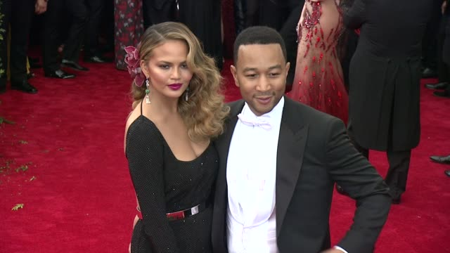 chrissy teigen and john legend at china through the looking glass costume institute benefit gala arrivals at metropolitan museum of art on may 04... - 2015 stock videos & royalty-free footage