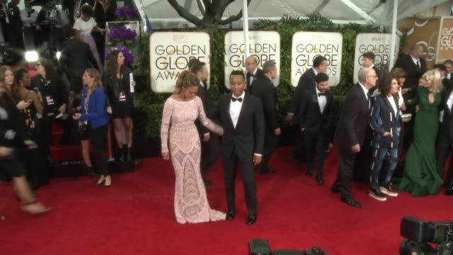Chrissy Teigen and John Legend at The Beverly Hilton Hotel on January 11 2015 in Beverly Hills California