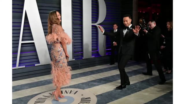 chrissy teigen and john legend attend the 2019 vanity fair oscar party hosted by radhika jones at wallis annenberg center for the performing arts on... - vanity fair stock videos and b-roll footage