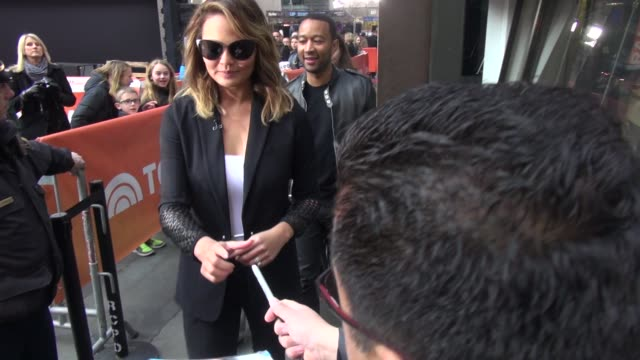 Chrissy Teigen leaving the TODAY show in Rockefeller Plaza signs for fans in Celebrity Sightings in New York