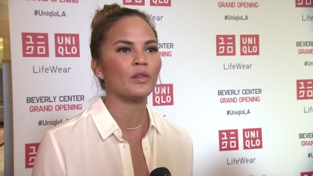 interview chrissy teigen on being excited about uniqlo in la on what she likes about their clothes and her must have itmes for fall/winter at uniqlo... - interview stock videos & royalty-free footage