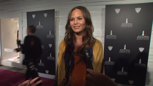chrissy teigen on what brings her out why its important to honor the fashion greats what she loves about her outfit and if she has been tweeting... - interview stock videos & royalty-free footage