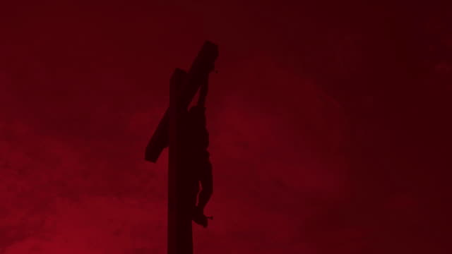 hd christ cross against red sky - kunst stock videos & royalty-free footage