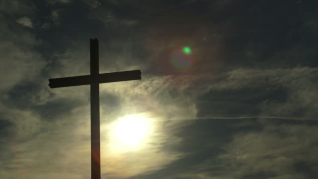 christ cross in the backlight pan an tl - bible stock videos & royalty-free footage