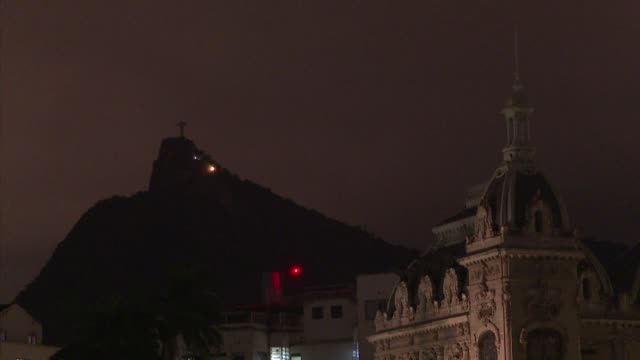 christ the redeemer the emblematic monument of rio de janeiro plunges into darkness for an hour on saturday as part of a global campaign to raise... - impact stock videos & royalty-free footage
