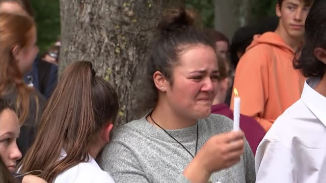 country mourns deaths of victims new zealand south island canterbury christchurch ext various young people doing haka dance at vigil woman crying and... - grief stock videos & royalty-free footage