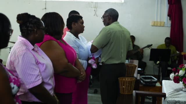 christening during a barbados gospel church service at speightstown - gottesdienst stock-videos und b-roll-filmmaterial