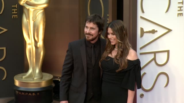 christian bale and sibi blazic - 86th annual academy awards - arrivals at hollywood & highland center on march 02, 2014 in hollywood, california. - hollywood and highland center stock videos & royalty-free footage