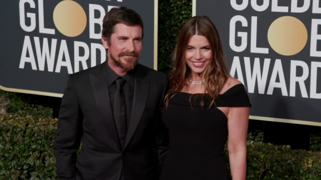 christian bale and sibi blazic at 76th annual golden globe awards arrivals in los angeles ca 1/6/19 4k footage - golden globe awards stock-videos und b-roll-filmmaterial