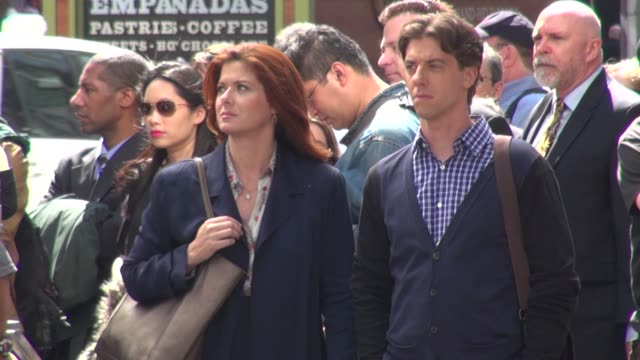 christian borle and debra messing on location for 'smash' in times square in new york ny on 09/12/12 - debra messing stock-videos und b-roll-filmmaterial