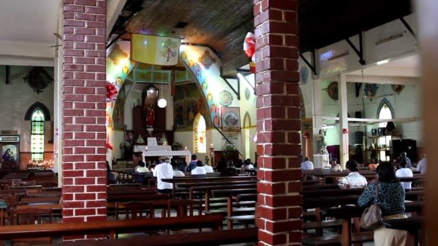 christian church with congregants praying - kampala stock-videos und b-roll-filmmaterial