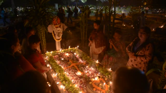 christian community offers prayer during the celebrations of all souls day in a cemetery in kolkata india november 02 2019 all souls day is observed... - after life stock videos & royalty-free footage