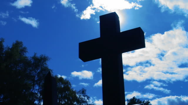 Christian cross and sun.