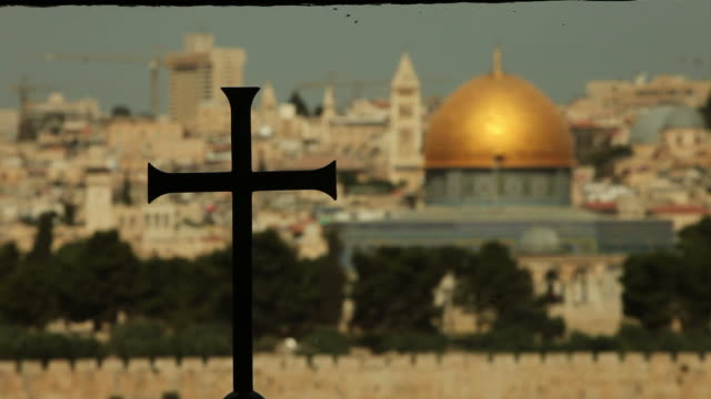 Christian Cross with Muslim Dome of the Rock in background
