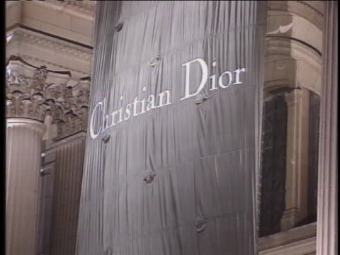 christian dior banner hangs at the museum of art costume institute ball. - metropolitan museum of art new york city stock videos & royalty-free footage
