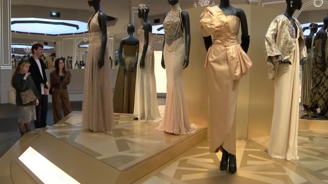 Christian Dior retrospective to open at London's Victoria Albert museum ENGLAND London Victoria and Albert Museum INT Various of display of dresses...