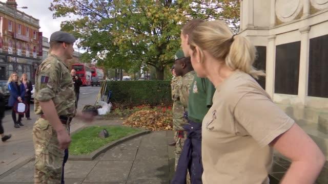 Christian Eriksen interview / war memorail general views ENGLAND London Wood Green EXT Christian Eriksen cleaning war memorial with army / closeup...