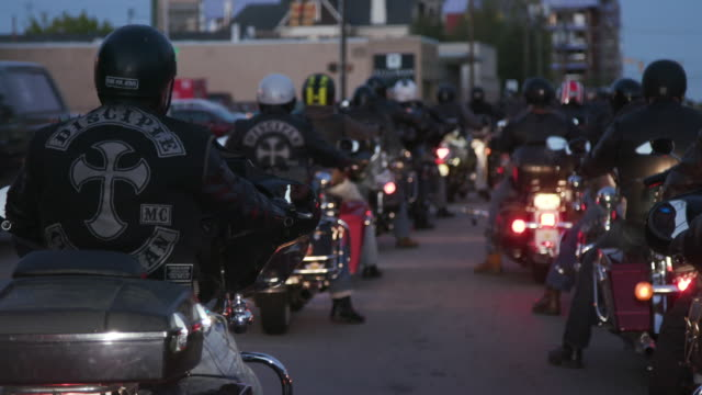 christian motorcycle club members drive away - bande stock-videos und b-roll-filmmaterial