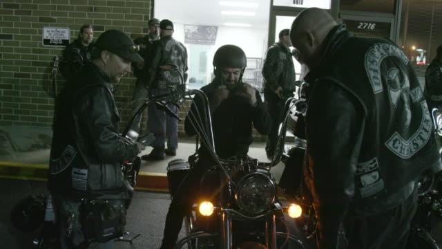 christian motorcycle club members hang out in parking lot - biker gang stock videos & royalty-free footage