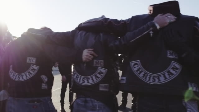 christian motorcycle club prays together - leather jacket stock videos & royalty-free footage
