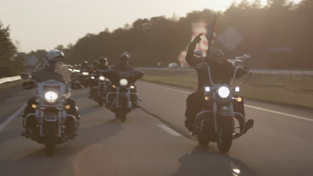 christian motorcycle club rides at sunset - motorway stock videos & royalty-free footage