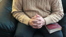 Christian person praying with hands clasped