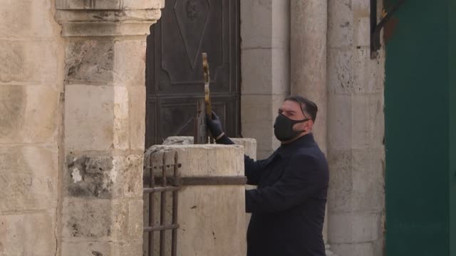 christian worshipper issa kassissieh walks down a deserted via dolorosa or way of the cross believed to be the route jesus walked carrying the cross... - worshipper stock videos & royalty-free footage
