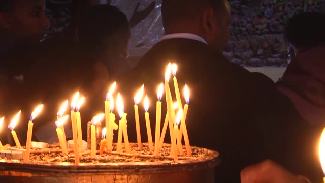 christians and tourists gather at the church of the nativity venerated by christians as the birthplace of jesus as part of the christmas celebrations... - church of the nativity stock videos and b-roll footage