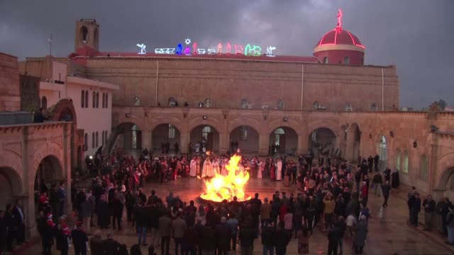 christians attend christmas mass monday evening in qaraqosh a predominantly christian village 30 km from mosul in iraq - christianity stock videos & royalty-free footage