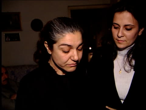christians free to celebrate christmas; news at ten: julian manyon iraq: baghdad: int group of iraqi christians singing hymn in candle light sot... - bell stock videos & royalty-free footage