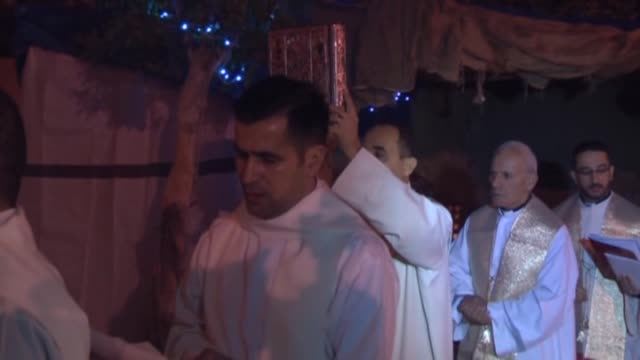 Christians living in Sulaymaniyah and Iraqi Christians fled from Islamic State of Iraq and the Levant attacks attend a christmas night mass held to...