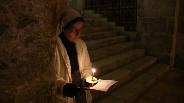 christians taking part in a processional mass at the church of the holy sepulchre in the old city of jerusalen on 23 december 2015 israeli police... - jerusalem old city stock videos and b-roll footage