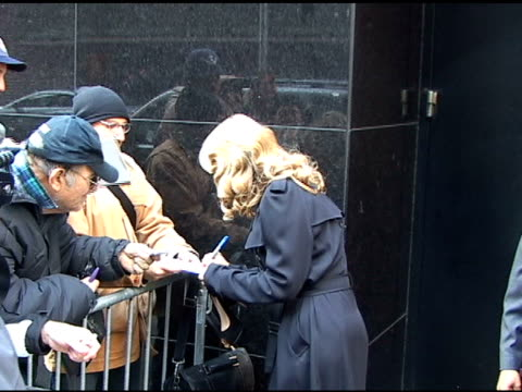 vídeos y material grabado en eventos de stock de christie brinkley signs autographs as she departs 'good morning america' in new york 04/6/11 - autografiar