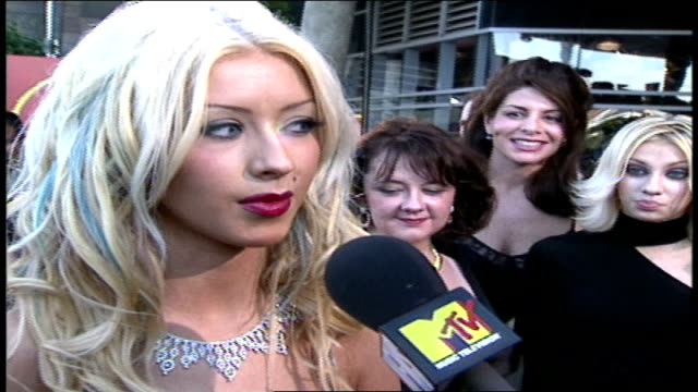 christina aguilera is discussing performing at the latin grammys, being exposed to spanish language and how that affected her decision to record an... - latin grammy awards stock videos & royalty-free footage