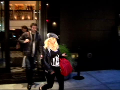christina aguilera rushes into her limo as she departs her hotel in new york 05/04/11 - christina aguilera stock videos & royalty-free footage