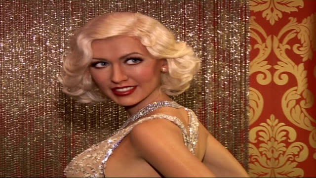 christina aguilera's waxwork at madame tussauds england london madame tussauds int waxwork of christina aguilera wearing long silver and white beaded... - madame tussauds stock videos & royalty-free footage