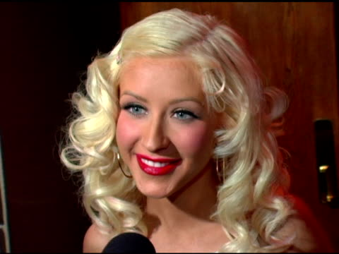 christina aguilera-wearing harve leger and christian louboutin shoes-discusses where the title 'back to basics' cames from, the influence of the... - persuasion stock videos & royalty-free footage