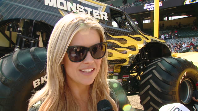christina anstead on tell us who are you here with today and what are you looking forward to seeing at monster jam, on which truck is your favorite... - angel stadium stock videos & royalty-free footage
