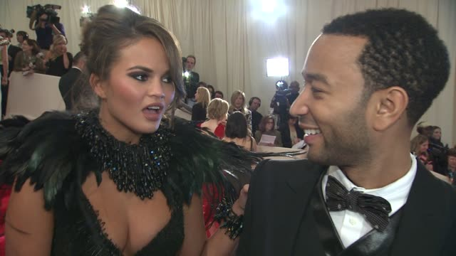 christine teigen and john legend legend shares what he thinks of bin laden's capture says teigen taught him about fashion says mcqueen had an edge... - interview stock videos & royalty-free footage