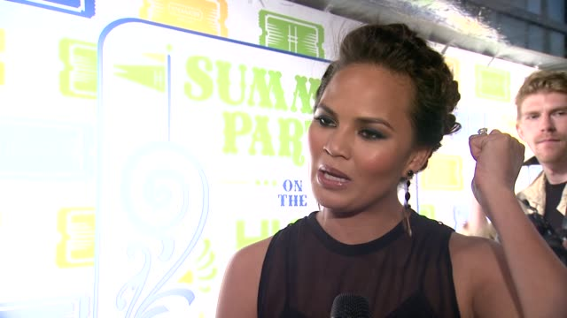 vídeos y material grabado en eventos de stock de interview christine teigen says she attended last year's coach party on coach being timeless yet contemporary on her summer party essentials at... - christine teigen