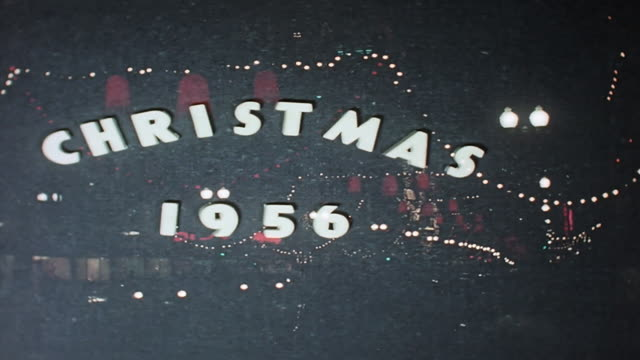 christmas 1956 decorated city street at night. - 1956 stock videos & royalty-free footage