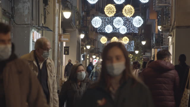 christmas 2020 at barcelona new normal. street crowd of people wearing masks during covid-19 crisis - b roll stock videos & royalty-free footage